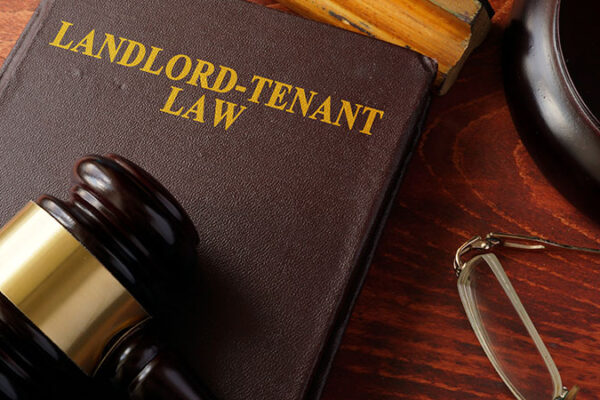 Landlord-Tenant Law Book with Gavel